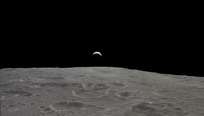 Earth rise as seen from the Moon during the Apollo 12 mission.
