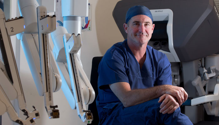 Prof Michael Wilson used a robot to perform part of Joanna Dean's heart surgery.