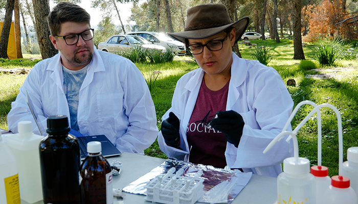 Dr Sophia Aharonovich carries out a soil sample test