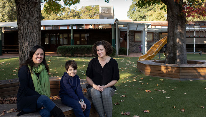 Dr Sara Mills at Macquarie University's MUSEC school with student Jayden and his mother Kerry.