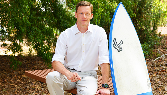 Nathan Hart is exploring the use of lights under surfboards as shark deterrants.