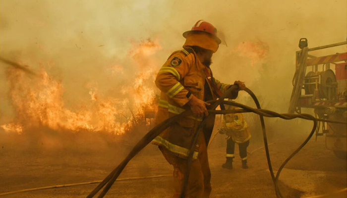 Firefighters from NSW Rurual Fire Service tackling bushfires in NSW