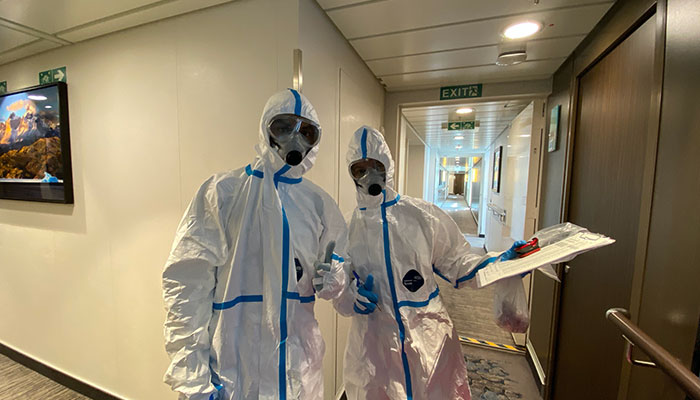 Border security staff in protective suits board the Greg Mortimer cruise ship in March 2020 after 81 per cent of passengers tested positive for covid-19.