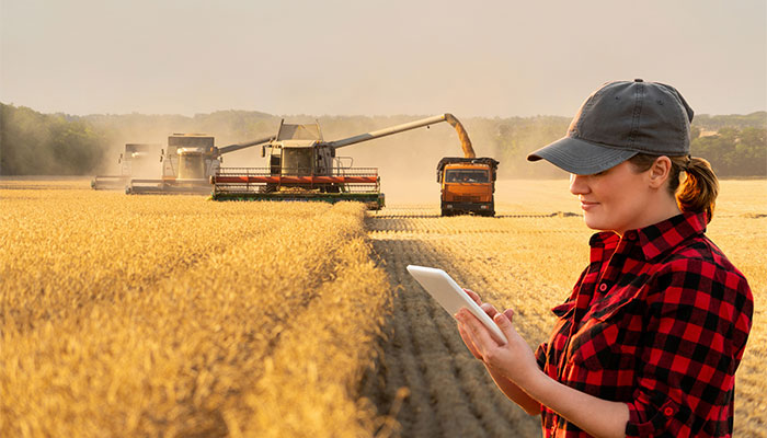 Woman using technology on farm