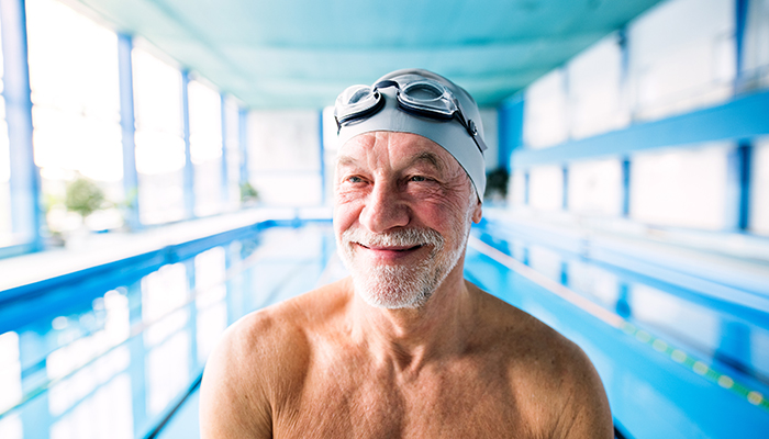 Older man swimming