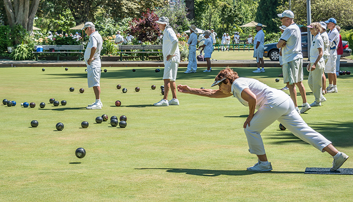 Woman playing lawn bowls